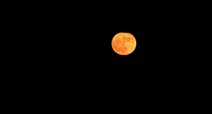 Hunters Full Moon, Full Of Color Tonight In Crystal Beach Tx On Bolivar Peninsula.